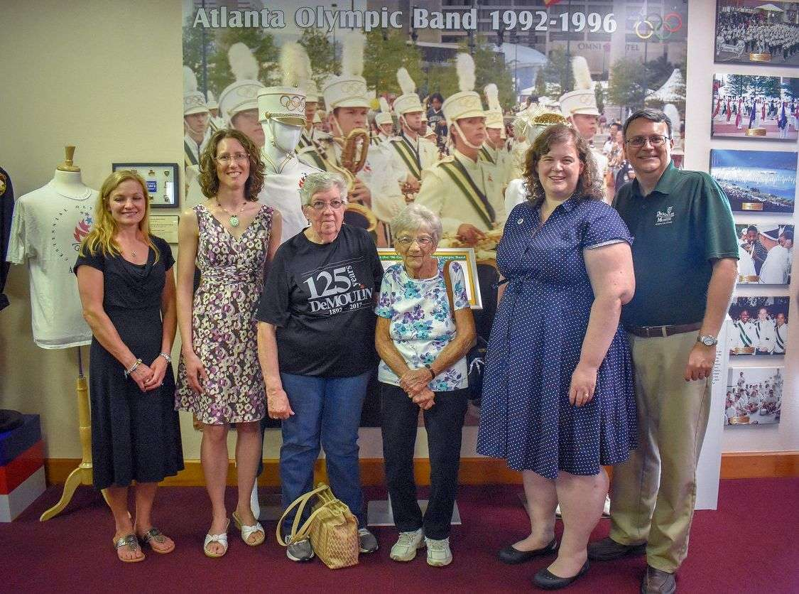 AOB band members Christy Casher, Lynne Snyder and Jill Sewell with DeMoulin employees Grace Haynes and Frances Ulmer, and DeMoulin Museum Curator John Goldsmith. (photo by Cera Douglas)