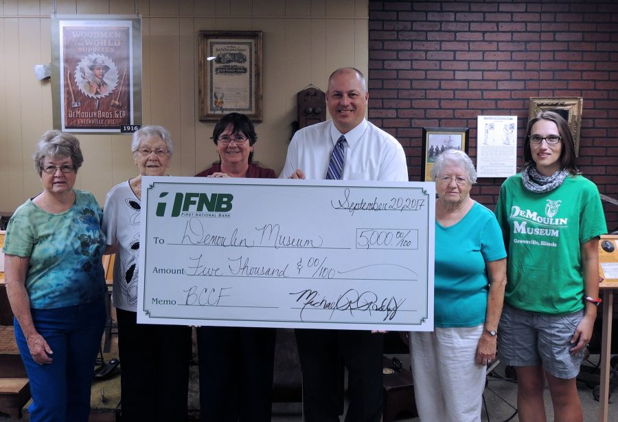 DeMoulin Museum volunteers participated in the check presentation
