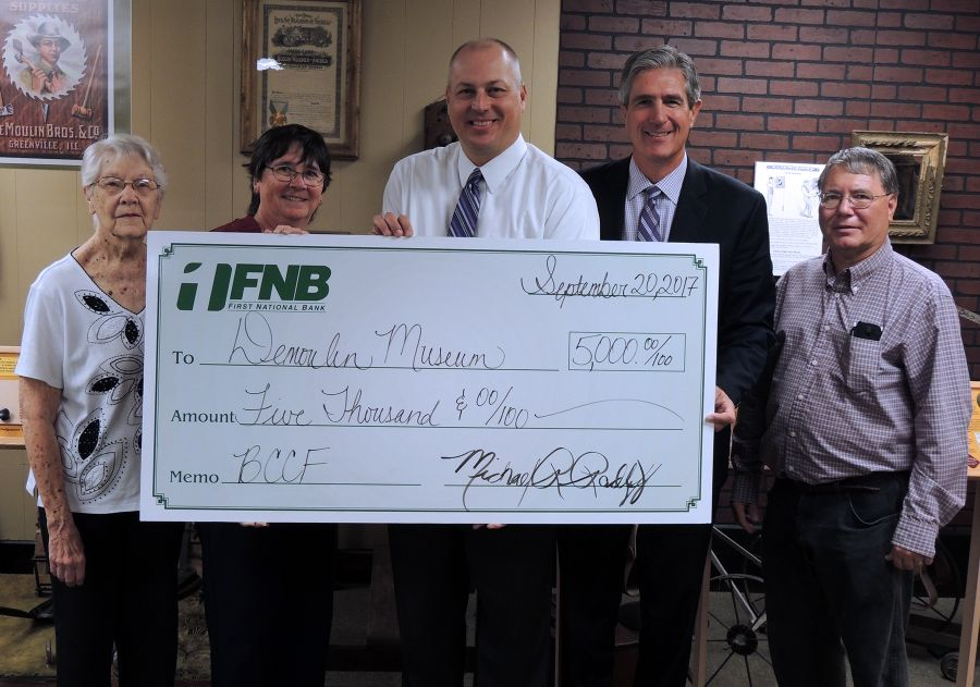 Members of the DeMoulin Museum Board of Directors participated in the check presentation