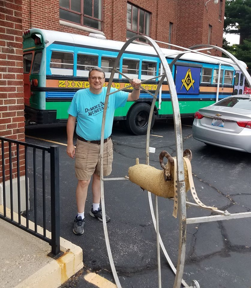 Museum curator with the Ferris Wheel Coaster Goat outside the Masonic Lodge.
