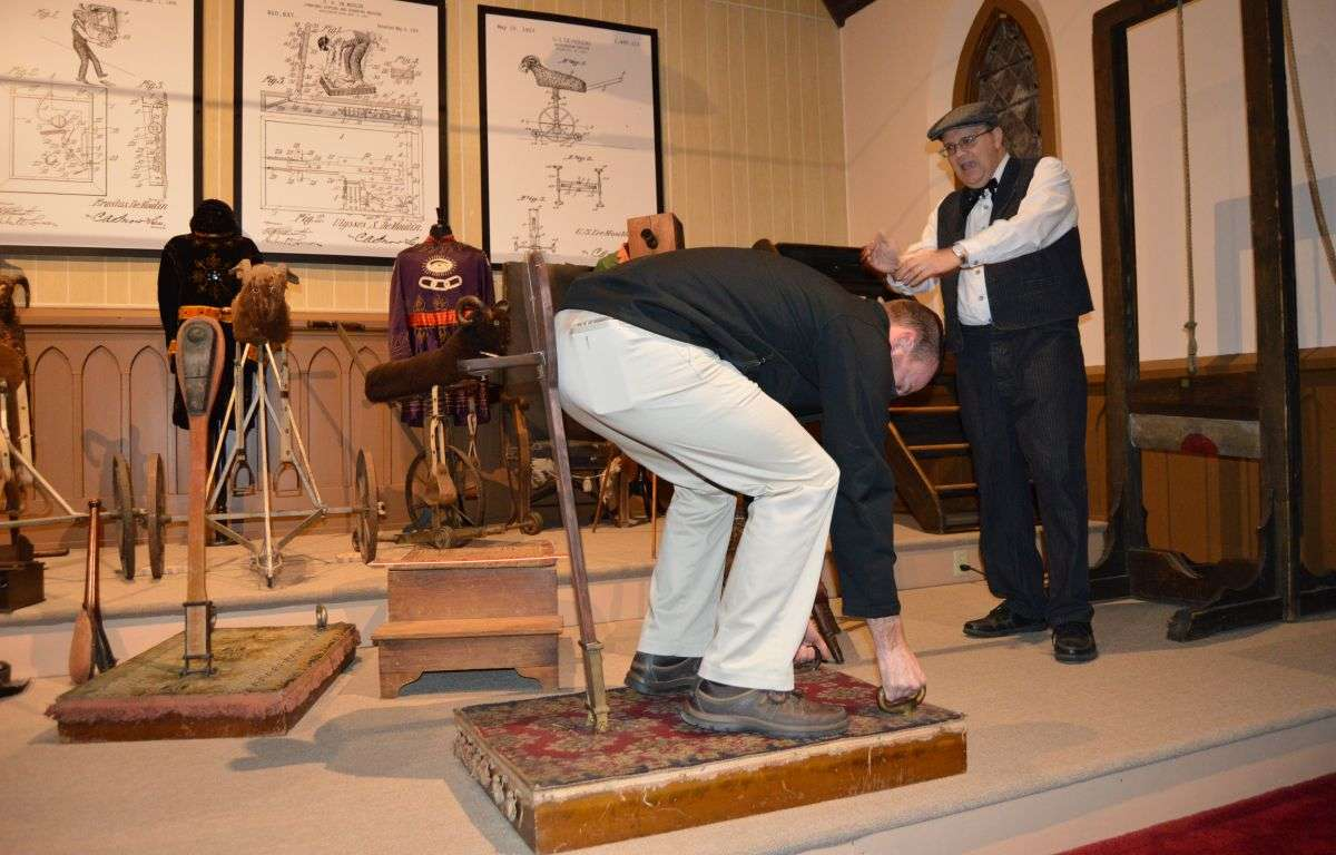 John Goldsmith, DeMoulin Museum curator demonstrates the Spanking Machine for a Re-Opening Sneak Preview in February 2018.